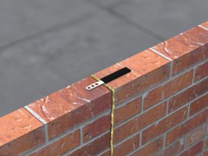 Movement wall tie in situ